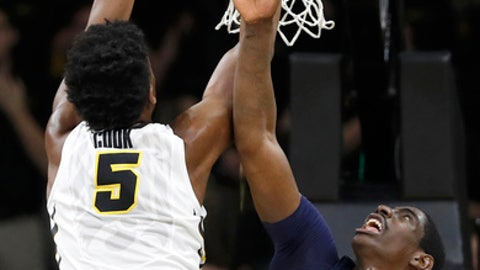 Iowa forward Tyler Cook (5) dunks over Penn State forward Mike Watkins (24) during the first half of an NCAA college basketball game, Sunday, March 5, 2017, in Iowa City, Iowa. (AP Photo/Charlie Neibergall)