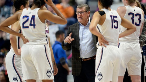 Connecticut head coach Geno Auriemma, center, talks to his team during a timeout during the first half of an NCAA college basketball game against Central Florid in the American Athletic Conference tournament semifinals at Mohegan Sun Arena, Sunday, March 5, 2017, in Uncasville, Conn. (AP Photo/Jessica Hill)