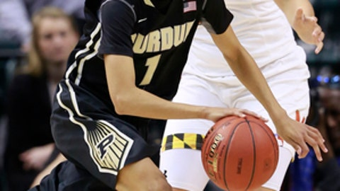 Purdue guard Ashley Morrissette (1) drives past Maryland guard Destiny Slocum during the first half of an NCAA college basketball game in the finals of the Big 10 conference tournament, Sunday, March 5, 2017, in Indianapolis. (AP Photo/R Brent Smith)