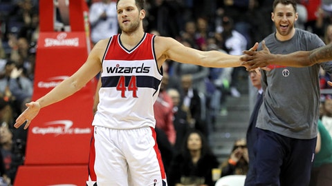 WASHINGTON, DC - MARCH 05: Bojan Bogdanovic #44 of the Washington Wizards celebrates with teammates after making the game-winning basket against the Orlando Magic during the second half at Verizon Center on March 5, 2017 in Washington, DC. NOTE TO USER: User expressly acknowledges and agrees that, by downloading and or using this photograph, User is consenting to the terms and conditions of the Getty Images License Agreement. (Photo by Patrick Smith/Getty Images)