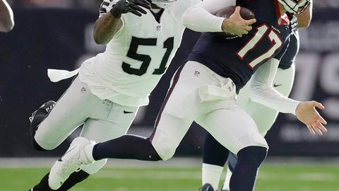 FILE - In this Jan. 7, 2017, file photo, Oakland Raiders outside linebacker Bruce Irvin (51) pursues Houston Texans quarterback Brock Osweiler (17) during the first half of an AFC Wild Card NFL football game, in Houston. Oakland general manager Reggie McKenzie had plenty of youth and needed playoff experience when he went on his spending spree last year. He brought in linebacker Bruce Irvin with two Super Bowl appearances from Seattle to ease the focus on Khalil Mack, and Irvin came through with seven sacks and six forced fumbles. (AP Photo/Eric Gay, File)