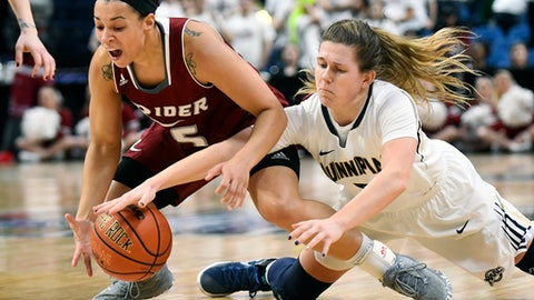 Rider guard Taylor Wentzel, left, and Quinnipiac guard Carly Fabbri (5) chase a loose ball during the first half of an NCAA college basketball game in the championship of the Metro Atlantic Athletic Conference tournament on Monday, March 6, 2017, in Albany, N.Y. (AP Photo/Hans Pennink)