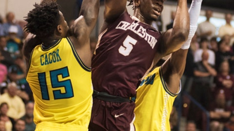 College of Charleston's Jarrell Brantley drives to the net between UNCW's Devontae Cacok and Chris Flemmings during the first half of an NCAA college basketball game in Charleston, S.C., Monday, March 6, 2017. (AP Photo/Mike Spencer)