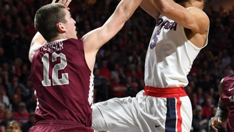LAS VEGAS, NV - MARCH 06:  Nigel Williams-Goss #5 of the Gonzaga Bulldogs is fouled by Matt Hauser #12 of the Santa Clara Broncos during a semifinal game of the West Coast Conference Basketball Tournament at the Orleans Arena on March 6, 2017 in Las Vegas, Nevada.  (Photo by Ethan Miller/Getty Images)