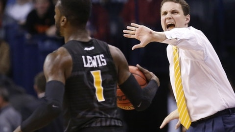 FILE - In this March 18, 2016, file photo, Virginia Commonwealth head coach Will Wade shouts to guard JeQuan Lewis (1) in the second half of a first-round men's college basketball game in the NCAA tournament in Oklahoma City.  In the final minute of VCU's regular-season ending victory against George Mason, coach Will Wade have all five of his seniors on the floor, and then took them out, one by one. These aren't the guys that took the Rams to that Final Four in 2001, but the ones that have kept the winning going. (AP Photo/Sue Ogrocki, File)
