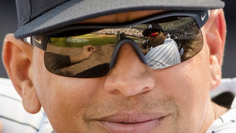 New York Yankees special advisor Alex Rodriguez speaks with CC Sabathia who reflected in his sunglasses ahead of a spring training baseball game against the Philadelphia Phillies, Friday, Feb. 24, 2017, in Tampa, Fla. (AP Photo/Matt Rourke)