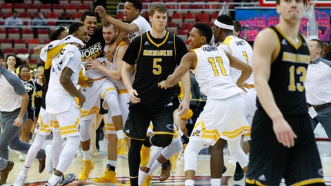 Northern Kentucky players celebrate their 59-53 victory over Milwaukee after the Horizon League NCAA college basketball tournament championship game in Detroit, Tuesday, March 7, 2017. (AP Photo/Paul Sancya)