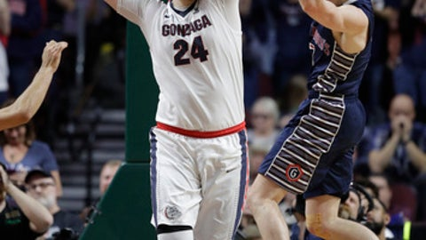Saint Mary's Emmett Naar, right, passes around Gonzaga's Przemek Karnowski in the first half of an NCAA college basketball game during the championship of the West Coast Conference tournament, Tuesday, March 7, 2017, in Las Vegas. (AP Photo/John Locher)