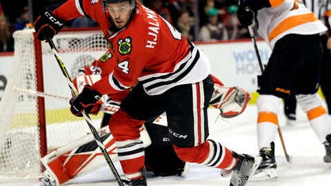 FILE - In this March 16, 2016, file photo, Chicago Blackhawks defenseman Niklas Hjalmarsson (4) controls the puck during the first period of an NHL hockey game against the Philadelphia Flyers in Chicago. The 29-year-old Hjalmarsson is skating again and looks ready to return Thursday night against Anaheim, giving Chicago a boost as it tries to chase down Minnesota for the Central Division title and top spot in the Western Conference. The durable defenseman has been sidelined for four straight games with an upper-body injury after missing a total of two games in the previous three seasons. (AP Photo/Nam Y. Huh, File)