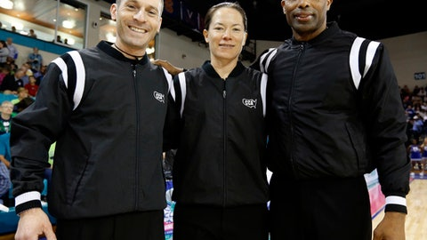 In this Sunday, March 5, 2017, photo, officials Joe Vaszily, from left, Maj Forsberg and Eric Brewton pose before the start of the women's basketball game between Duke and Notre Dame at the NCAA college championship basketball game in the Atlantic Coast Conference tournament at the HTC Center in Conway, S.C. (AP Photo/Mic Smith)
