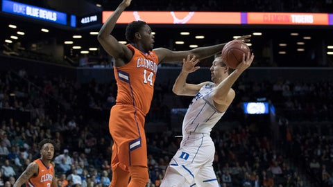 Clemson forward Elijah Thomas (14) guards Duke's Luke Kennard during the second half of an NCAA college basketball game in the Atlantic Coast Conference tournament, Wednesday, March 8, 2017, in New York. Duke won 79-72. (AP Photo/Mary Altaffer)