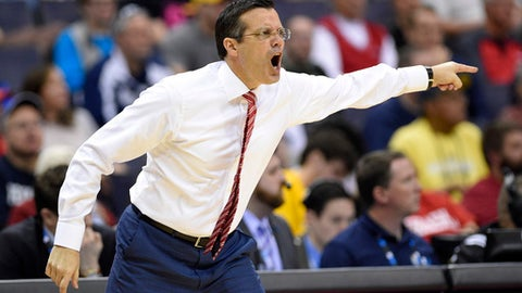 Nebraska head coach Tim Miles points during the first half of an NCAA college basketball game in the Big Ten Conference tournament against the Penn State, Wednesday, March 8, 2017, in Washington. (AP Photo/Nick Wass)