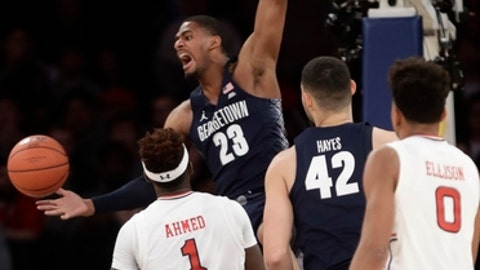 Georgetown's Rodney Pryor (23) dunks in fron tof St. John's Bashir Ahmed (1) and Malik Ellison (0) during the first half of an NCAA college basketball game during the Big East men's tournament Wednesday, March 8, 2017, in New York. (AP Photo/Frank Franklin II)