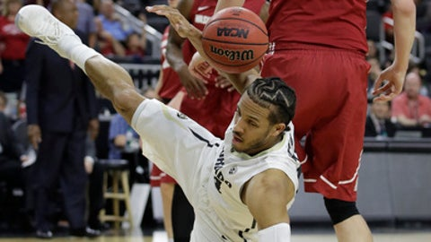 Colorado's Josh Fortune falls to the ground after scoring against Washington State during the first half of an NCAA college basketball game in the first round of the Pac-12 men's tournament Wednesday, March 8, 2017, in Las Vegas. (AP Photo/John Locher)