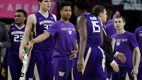 Washington's Markelle Fultz, center left, congratulates teammates during the first half of an NCAA college basketball game against Southern California in the first round of the Pac-12 men's tournament Wednesday, March 8, 2017, in Las Vegas. (AP Photo/John Locher)