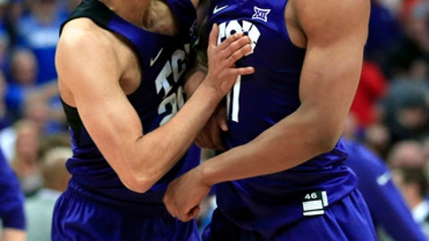 TCU guards Alex Robinson, left, and Brandon Parrish (11) celebrate following an NCAA college basketball game against Kansas in the quarterfinal round of the Big 12 tournament in Kansas City, Mo., Thursday, March 9, 2017. TCU defeated Kansas 85-82. (AP Photo/Orlin Wagner)