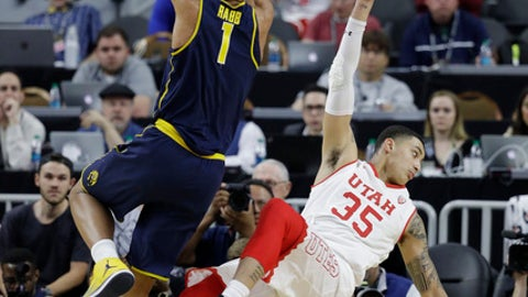 California's Ivan Rabb (1) fouls Utah's Kyle Kuzma during the first half of an NCAA college basketball game in the quarterfinals of the Pac-12 men's tournament Thursday, March 9, 2017, in Las Vegas. (AP Photo/John Locher)