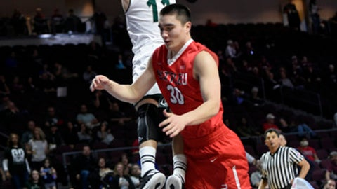 Utah Valley's Conner Toolson (11) is fouled by Seattle's Zackary Moore during the second half of an NCAA college basketball game in the first round of the Western Athletic Conference tournament Thursday, March 9, 2017, in Las Vegas. (AP Photo/David Becker)