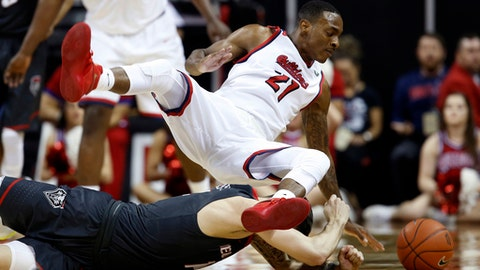 Fresno State's Deshon Taylor (21) and New Mexico's Dane Kuiper are tripped while going after the ball during the second half of an NCAA college basketball game in the Mountain West Conference tournament Thursday, March 9, 2017, in Las Vegas. (AP Photo/Isaac Brekken)
