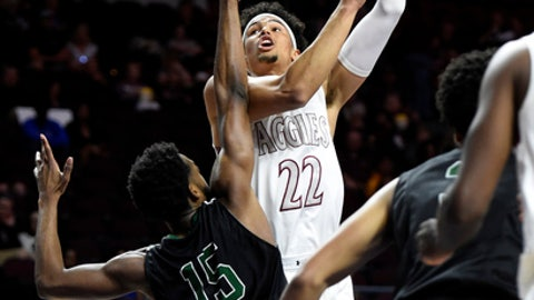 New Mexico State's Eli Chuha (22) shoots against Chicago State's Trayvon Palmer during the first half of an NCAA college basketball game in the first round of the Western Athletic Conference tournament Thursday, March 9, 2017, in Las Vegas. (AP Photo/David Becker)