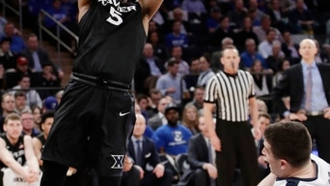 Xavier's Trevon Bluiett (5) shoots over Butler's Andrew Chrabascz (45) during the second half of an NCAA college basketball game during the Big East men's tournament Thursday, March 9, 2017, in New York. (AP Photo/Frank Franklin II)