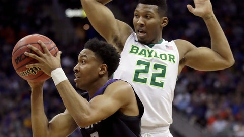 Kansas State's Kamau Stokes (3) shoots under pressure from Baylor's King McClure (22) during the first half of an NCAA college basketball game in the quarterfinal round of the Big 12 tournament in Kansas City, Mo., Thursday, March 9, 2017. (AP Photo/Charlie Riedel)