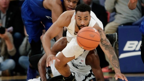 Providence's Jalen Lindsey (21) dives for the ball as Creighton's Justin Patton (23) watches during the first half of an NCAA college basketball game during the Big East men's tournament Thursday, March 9, 2017, in New York. (AP Photo/Frank Franklin II)