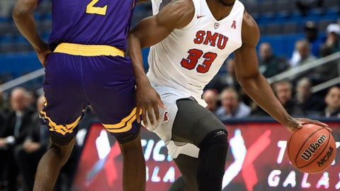 East Carolina's Caleb White, left, grabs the shirt of SMU's Semi Ojeleye, right, as he dribbles during the first half of an NCAA college basketball game in the American Athletic Conference tournament quarterfinals, Friday, March 10, 2017, in Hartford, Conn. (AP Photo/Jessica Hill)