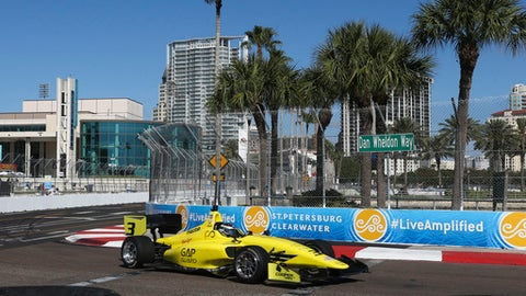 A race car takes a turn during practice for the Grand Prix of St. Petersburg IndyCar race in St. Petersburg, Fla., Friday, March 10, 2017.   (Dirk Shadd/Tampa Bay Times via AP)