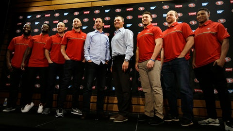 From left to right, San Francisco 49ers' Pierre Garçon, Marquise Goodwin, Robbie Gould, quarterback Brian Hoyer, head coach Kyle Shanahan, general manager John Lynch, Kyle Juszczyk, Logan Paulsen and Malcolm Smith stand for a photo at the end of a media conference Friday, March 10, 2017, in Santa Clara, Calif. (AP Photo/Ben Margot)