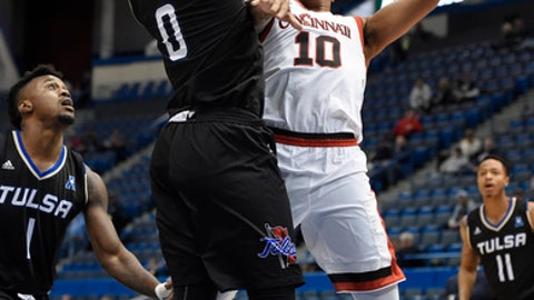 Cincinnati's Troy Caupain shoots as Tulsa's Junior Etou, left, defends during the first half of an NCAA college basketball game in the American Athletic Conference tournament quarterfinals, Friday, March 10, 2017, in Hartford, Conn. (AP Photo/Jessica Hill)