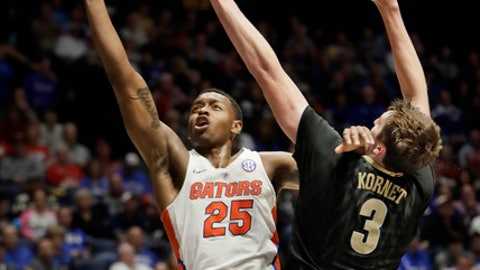 Florida forward Keith Stone (25) shoots past the reach of Vanderbilt forward Luke Kornet (3) during the second half of an NCAA college basketball game at the Southeastern Conference tournament Friday, March 10, 2017, in Nashville, Tenn. (AP Photo/Wade Payne)