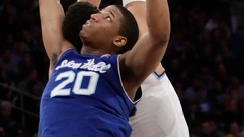 Seton Hall's Desi Rodriguez (20) and Villanova's Josh Hart (3) fight for the ball during the second half of an NCAA college basketball game during the Big East men's tournament Friday, March 10, 2017, in New York. Villanova won 55-53. (AP Photo/Frank Franklin II)