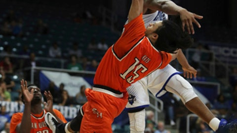 Sam Houston State guard Josh Delaney (15) gets off a shot under pressure by New Orleans forward Travin Thibodeaux during the second half of an NCAA college basketball game in the Southland Conference tournament Friday, March 10, 2017, in Katy, Texas. (Steve Gonzales/Houston Chronicle via AP)