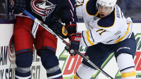 Buffalo Sabres' Evan Rodrigues checks Columbus Blue Jackets' Kyle Quincey during the third period of an NHL hockey game Friday, March 10, 2017, in Columbus, Ohio. The Blue Jackets beat the Sabres 4-3. (AP Photo/Jay LaPrete)