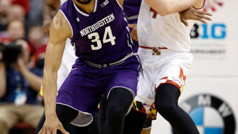 Northwestern guard Sanjay Lumpkin (34) dribbles the ball as Maryland guard Kevin Huerter (4) defends during the first half of an NCAA college basketball game in the Big Ten tournament, Friday, March 10, 2017, in Washington. (AP Photo/Alex Brandon)