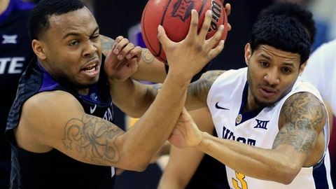 Kansas State guard Carlbe Ervin II (1) beats West Virginia guard James Bolden (3) to the ball during first half of an NCAA college basketball game in the semifinals of the Big 12 tournament in Kansas City, Mo., Friday, March 10, 2017. (AP Photo/Orlin Wagner)