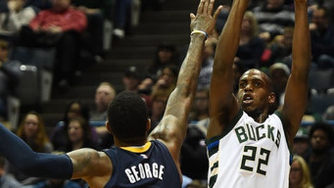 MILWAUKEE, WI - MARCH 10:  Khris Middleton #22 of the Milwaukee Bucks shoots over Paul George #13 of the Indiana Pacers during the first half of a game at the BMO Harris Bradley Center on March 10, 2017 in Milwaukee, Wisconsin.  NOTE TO USER: User expressly acknowledges and agrees that, by downloading and or using this photograph, User is consenting to the terms and conditions of the Getty Images License Agreement.  (Photo by Stacy Revere/Getty Images)