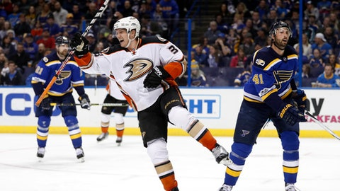 Anaheim Ducks' Jakob Silfverberg, Sweden, celebrates between St. Louis Blues' Patrik Berglund, left, of Sweden, and Robert Bortuzzo, right, after scoring during the third period of an NHL hockey game Friday, March 10, 2017, in St. Louis. The Blues won 4-3. (AP Photo/Jeff Roberson)