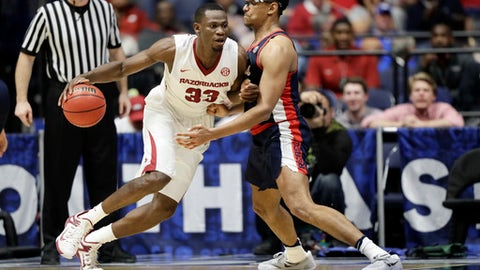 Arkansas forward Moses Kingsley (33) drives against Mississippi forward Sebastian Saiz, right, during the second half of an NCAA college basketball game at the Southeastern Conference tournament Friday, March 10, 2017, in Nashville, Tenn. (AP Photo/Wade Payne)