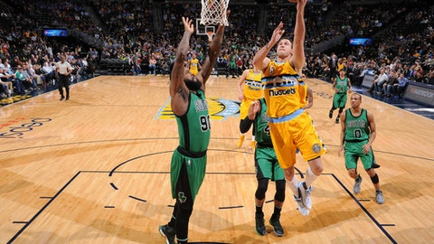 DENVER, CO - MARCH 10: Danilo Gallinari #8 of the Denver Nuggets goes up for a lay up against the Boston Celtics on March 10, 2017 at the Pepsi Center in Denver, Colorado. NOTE TO USER: User expressly acknowledges and agrees that, by downloading and/or using this Photograph, user is consenting to the terms and conditions of the Getty Images License Agreement. Mandatory Copyright Notice: Copyright 2017 NBAE (Photo by Garrett Ellwood/NBAE via Getty Images)