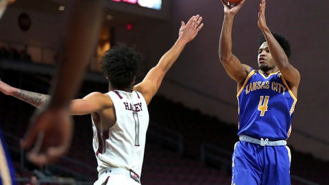 UMKC guard LaVell Boyd (4) shoots over UMKC guard Dashawn King (1) during the first half of an NCAA college basketball game in the semifinals of the Western Athletic Conference tournament Friday, March 10, 2017 in Las Vegas. (AP Photo/L.E. Baskow)
