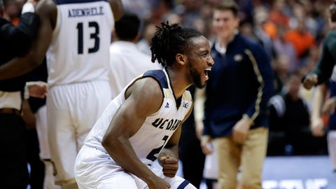 UC Davis' Darius Graham celebrates his team's 66-64 overtime win against Cal State Fullerton in an NCAA college basketball game at the Big West men's tournament Friday, March 10, 2017, in Anaheim, Calif. (AP Photo/Jae C. Hong)