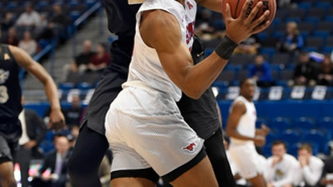 Central Florida's Tacko Fall, back, guards SMU's Jarrey Foster during the first half of an NCAA college basketball game in the American Athletic Conference tournament semifinals, Saturday, March 11, 2017, in Hartford, Conn. (AP Photo/Jessica Hill)
