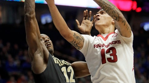 Arkansas forward Dustin Thomas (13) shoots against Vanderbilt center Djery Baptiste (12) in the first half of an NCAA college basketball game in the semifinals of the Southeastern Conference tournament Saturday, March 11, 2017, in Nashville, Tenn. (AP Photo/Wade Payne)