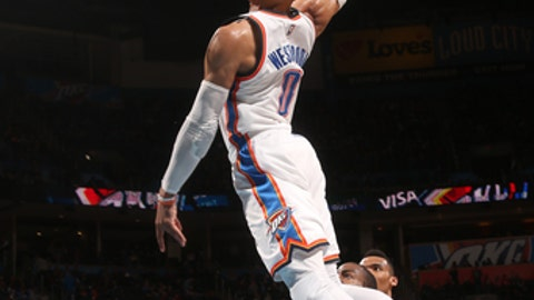 OKLAHOMA CITY, OK - MARCH 11:  Russell Westbrook #0 of the Oklahoma City Thunder goes up for a dunk during a game against the Utah Jazz on March 11, 2017 at Chesapeake Energy Arena in Oklahoma City, Oklahoma. NOTE TO USER: User expressly acknowledges and agrees that, by downloading and/or using this photograph, user is consenting to the terms and conditions of the Getty Images License Agreement. Mandatory Copyright Notice: Copyright 2017 NBAE (Photo by Layne Murdoch/NBAE via Getty Images)