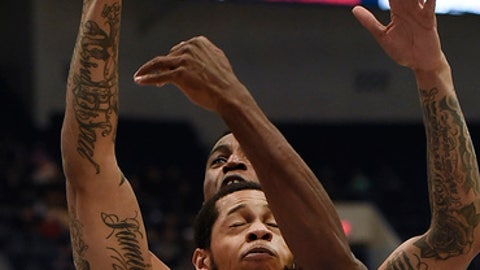 Connecticut's Kentan Facey, back fouls Cincinnati's Quadri Moore during the first half of an NCAA college basketball game in the American Athletic Conference tournament semifinals, Saturday, March 11, 2017, in Hartford, Conn. (AP Photo/Jessica Hill)