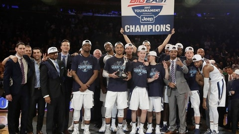 Villanova poses for photographs with the tournament trophy after a championship NCAA college basketball game against Creighton in the finals of the Big East men's tournament Saturday, March 11, 2017, in New York. Villanova won 74-60. (AP Photo/Frank Franklin II)