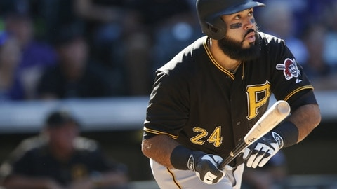 FILE - In this Sept. 24, 2015, file photo, Pittsburgh Pirates' Pedro Alvarez watches his three-run home run off Colorado Rockies relief pitcher Jairo Diaz during the eighth inning of a baseball game in Denver. A person familiar with the negotiations says Alvarez has agreed to a minor league contract to return to the Baltimore Orioles. The person spoke to The Associated Press on condition of anonymity Saturday, March 11, 2017 because the agreement had not been announced. (AP Photo/David Zalubowski, File)
