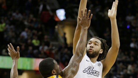 Akron's Kwan Cheatham, right, shoots over Kent State's Deon Edwin during the first half of an NCAA college basketball championship game of the Mid-American Conference tournament, Saturday, March 11, 2017, in Cleveland. (AP Photo/Tony Dejak)